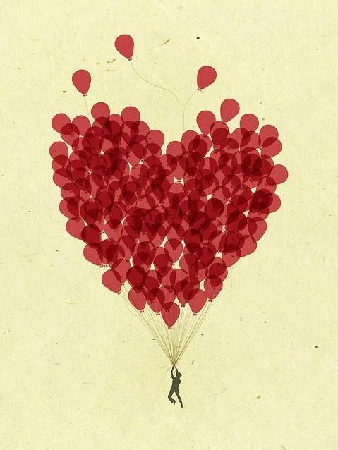 Tanti palloncini rossi che formano un grande Cuore